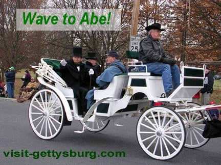 Abe Lincoln waves from his carriage